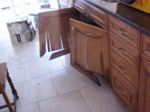 Cabinets falling apart from 280,000 gallons of water